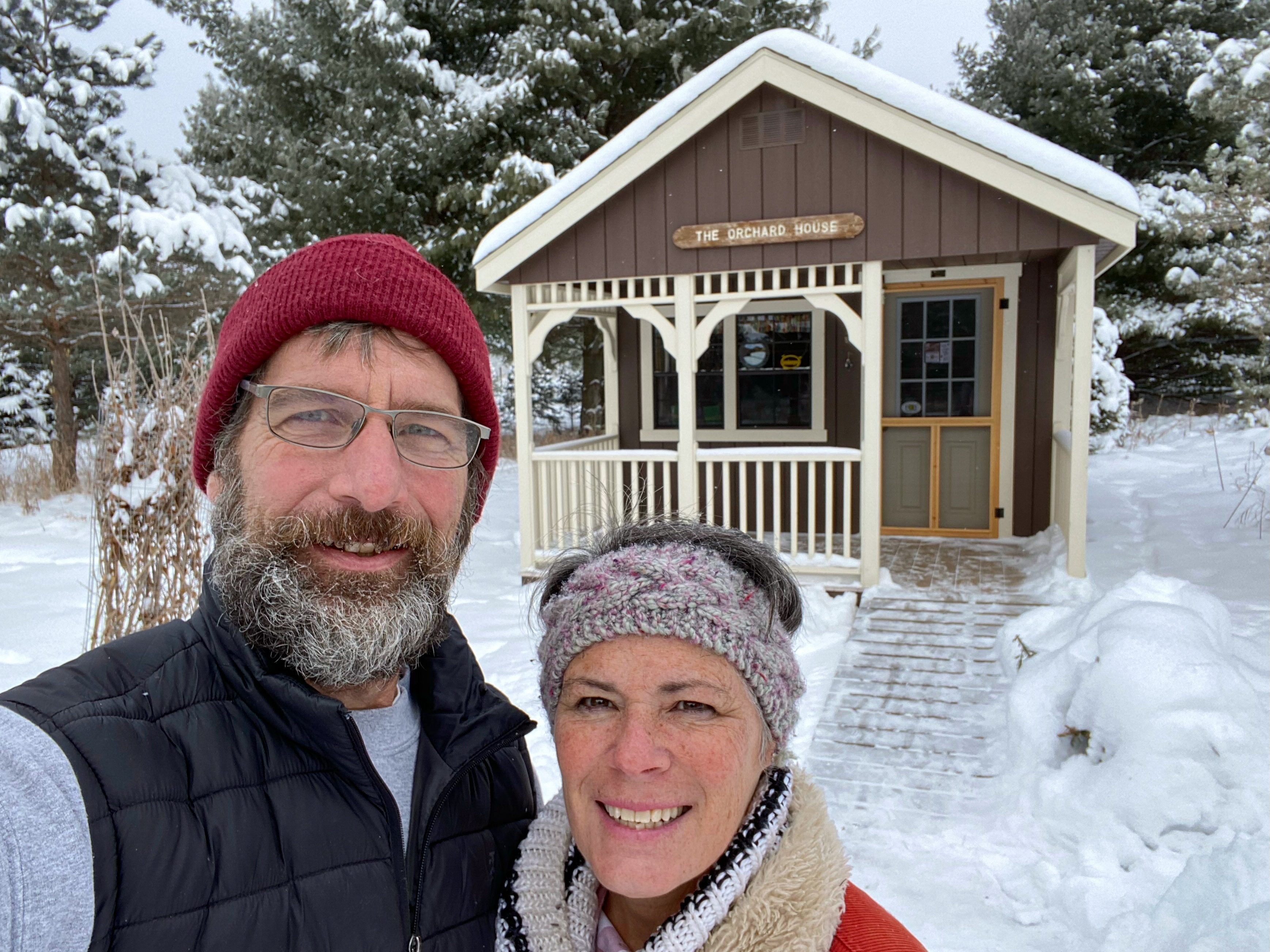Kim and Craig Yolitz at McKenzie Orchard in Spooner Wisconsin in front of their retail cabin shed store