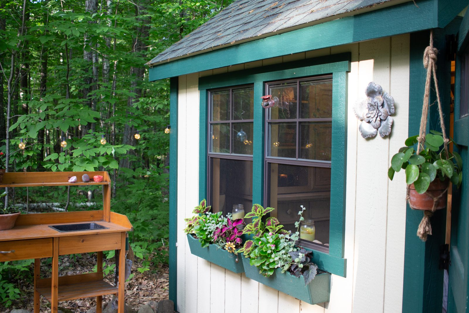 flower boxes on she shed northern wisconsin