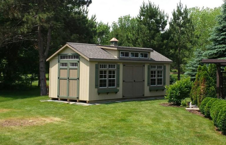 storage shed with window shutters and flowerboxes