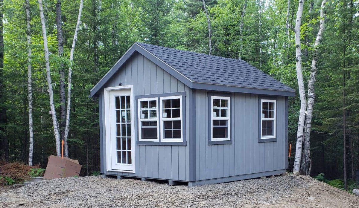 small storage shed on gravel pad